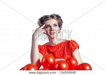 She thought and looking for solutions on a white background. The red dress with red balls.