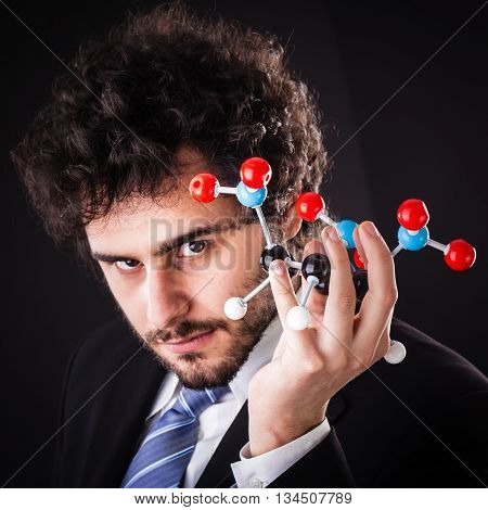 Businessman Holding Tnt Atomic Structure