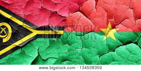 Vanatu flag with Burkina Faso flag on a grunge cracked wall