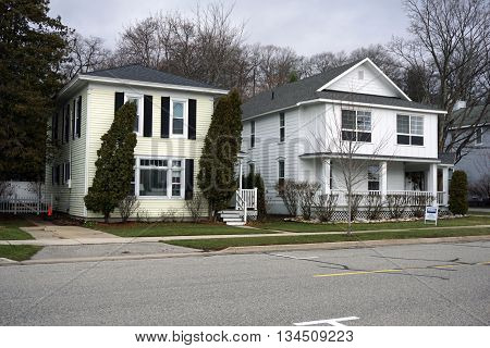 HARBOR SPRINGS, MICHIGAN / UNITED STATES - DECEMBER 24, 2015: Two homes on Third Street near downtown Harbor Springs.