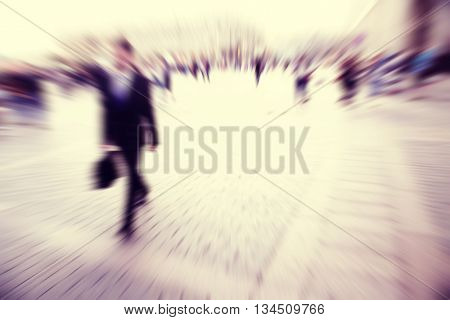 Motion blurred image of businessman walking in the city.