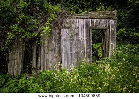 Abandoned Building In Ghost Town. Old wooden building in the abandoned ghost town of Fayette State Park in Garden, Michigan.