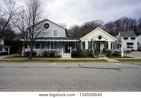 HARBOR SPRINGS, MICHIGAN / UNITED STATES - DECEMBER 24, 2015: Johan's Bakery is connected to a large home on Third Street in downtown Harbor Springs.