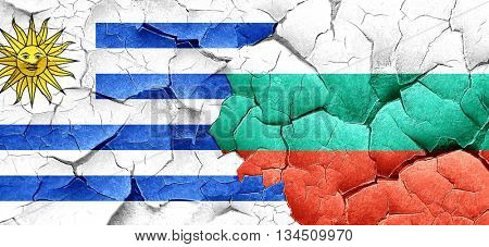 Uruguay flag with Bulgaria flag on a grunge cracked wall