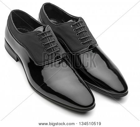Black patent leather men shoes isolated on white background.