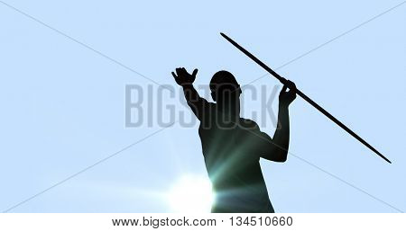 Rear view of man throwing javeline against white background against blue background
