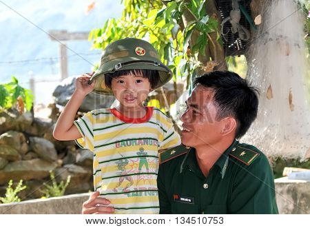 BAC GIANG, VIET NAM, June 21, 2016 girls, enjoy military outfit. The daughter soldier Bac Giang People's Army, Vietnam