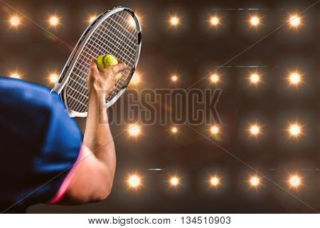 Tennis player holding a racquet ready to serve against composite image of orange spotlight