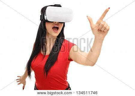 Joyful woman looking in VT goggles isolated on white background