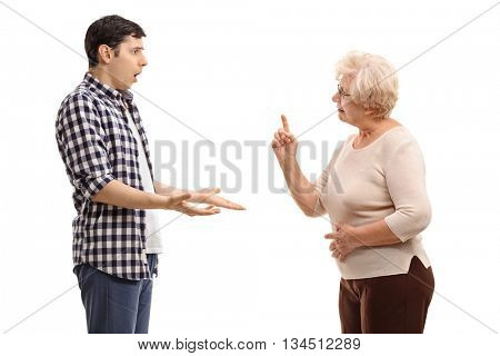 Studio shot of a young man arguing with a mature woman isolated on white background