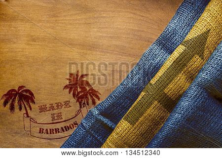 Hot stamping on a wooden surface - Made in Barbados. Barbados flag State.
