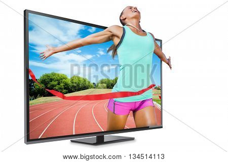 Sportswoman celebrating her victory against high angle view of track