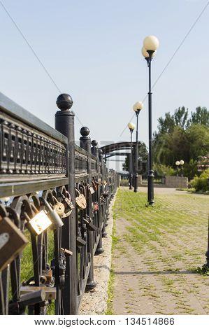 Love locks locked on the fence of the bridge in Ljubljana Slovenia
