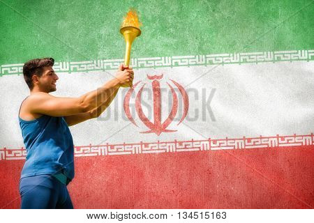 Low angle view of sportsman holding a cup against digitally generated iran national flag