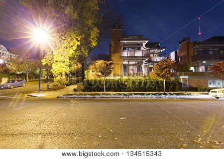 night scene of road near residential buildings in seattle,which has beautiful back yard