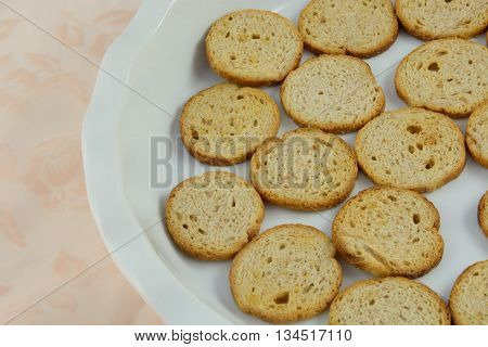 Appetizer party snack preparation of melba toast in dish on tablecloth