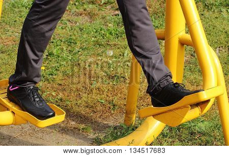 Woman Exercising Lower Body On Outdoor Gym, Healthy Lifestyle