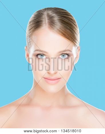 Portrait of young, beautiful and healthy woman over cyan background