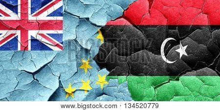 Tuvalu flag with Libya flag on a grunge cracked wall