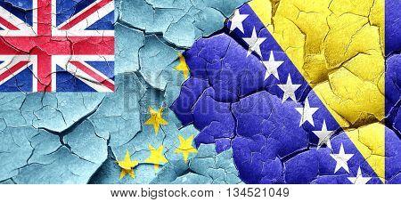 Tuvalu flag with Bosnia and Herzegovina flag on a grunge cracked