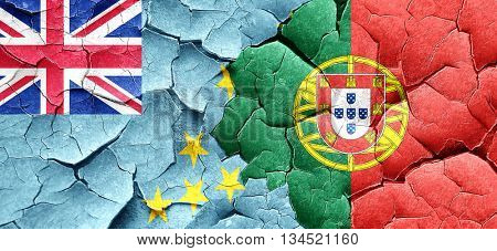 Tuvalu flag with Portugal flag on a grunge cracked wall