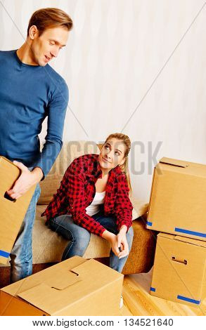 Young couple with boxes - packing or unpacking