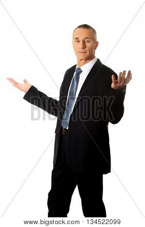 Businessman with open hands in undecided gesture