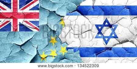Tuvalu flag with Israel flag on a grunge cracked wall