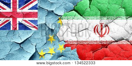 Tuvalu flag with Iran flag on a grunge cracked wall