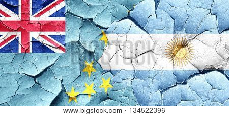 Tuvalu flag with Argentine flag on a grunge cracked wall