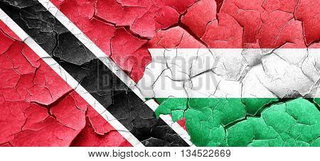 Trinidad and tobago flag with Hungary flag on a grunge cracked w