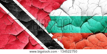 Trinidad and tobago flag with Bulgaria flag on a grunge cracked