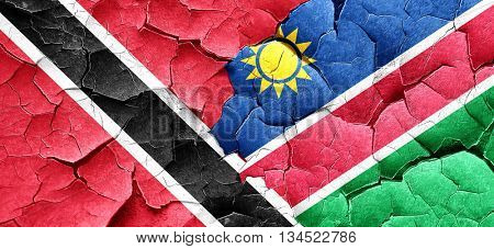 Trinidad and tobago flag with Namibia flag on a grunge cracked w