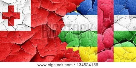 Tonga flag with Central African Republic flag on a grunge cracke