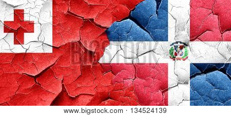 Tonga flag with Dominican Republic flag on a grunge cracked wall