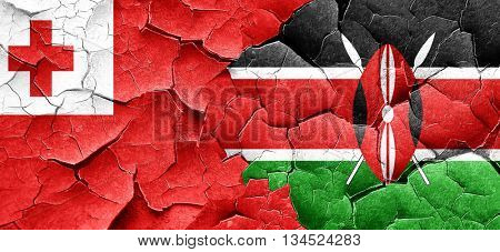 Tonga flag with Kenya flag on a grunge cracked wall