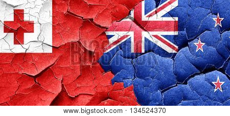 Tonga flag with New Zealand flag on a grunge cracked wall