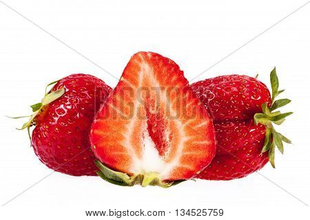 fruits of red cut strawberries isolated on white background.
