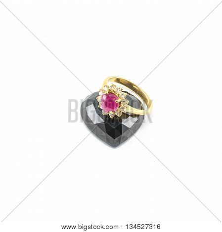 Closeup beautiful pink pebble ring with black jasper in heart shape isolated on white background