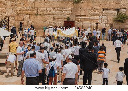 Jerusalem Israel - May 9 2016: Jewish worshipers gather for a Bar Mitzvah ritual at the Western wall in Jerusalem.
