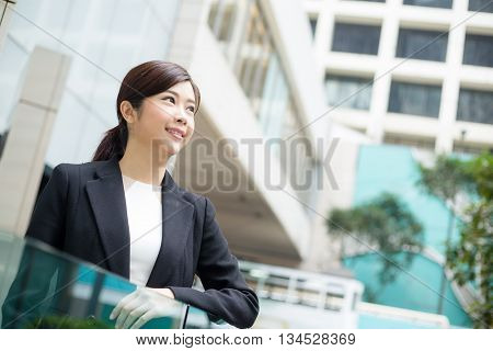 Businesswoman looking far away
