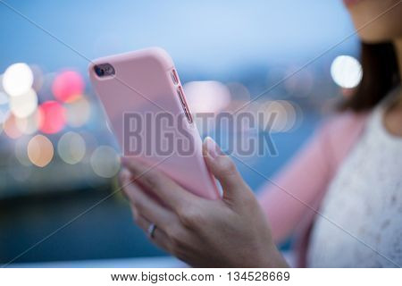 Woman use of cellphone at night