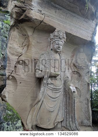 The complex of Buddhist rock sculptures located near monastery Mingshansi in remote rural areas (about 55 km from the county capital Anyue, Sichuan province, China). The heights of the 13 statues carved from rock are 4-6 m.