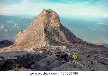 Ranau,Sabah,Borneo-April 30,2014:Group of climbers hiking down Mount Kinabalu after succesfully conquer it. Mount Kinabalu is the highest mountain on the island of Borneo(4,095m).