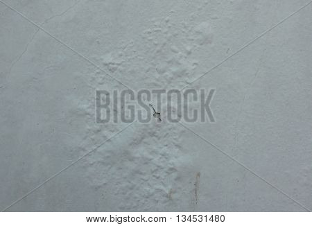 paint color swelling on old white building wall