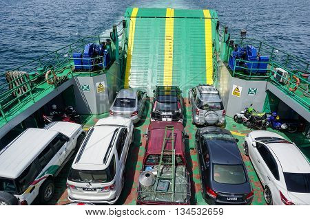 Labuan,Malaysia-Jun 12,2016:Putra Jaya ferry with vehicles on board,carries passengers and vehicles from Menumbok Sabah to Labuan Island.This is the most economical connect Labuan FT and the Borneo