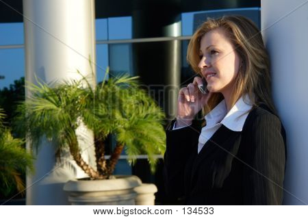 Blond Business Woman Talking On Cell