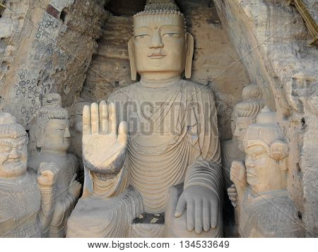 The 28 m Giant Buddha (Dafo) of buddhist cave complex Tiantishan (Tiantishan Grottoes) is located approximately 55 km south-east of Wuwei (Gansu, China) on the rocky eastern shore of the Huangyang reservoir, 12 m below the water level.