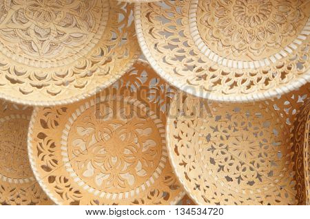 Plates and sugar bowls made of birch bark, Russian folk art ,paintings on birch bark is applied in two ways: embossing or oil paints.