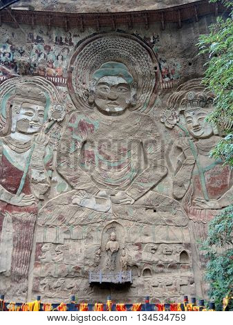 The 43 m giant bas-relief of Buddha Vairochana and two bodhisattvas is situated in Natural Park Shuiliandong, which is located approximately 100 km from the town of Tianshui in Gansu Province, China.